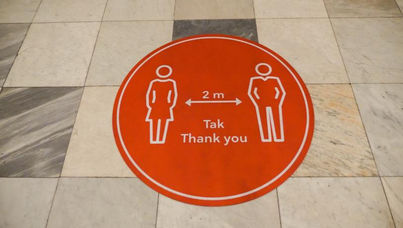 A keep your distance sticker on the floor in Denmark, to help avoid the spread of coronavirus